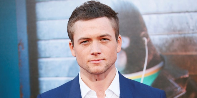 """Actor Taron Egerton poses at the world premiere of the film """"Sing"""" in Los Angeles, California, December 3, 2016. REUTERS/Danny Moloshok - RTSUJBM"""