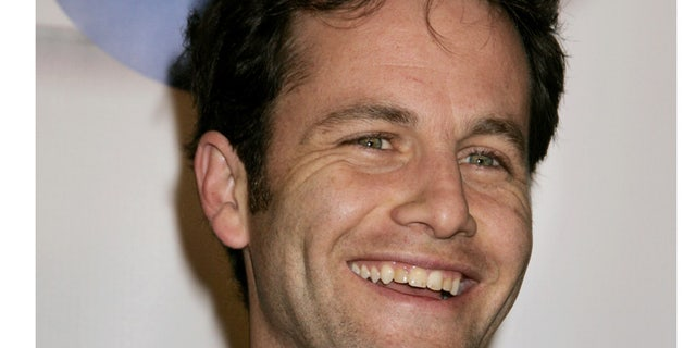 Actor Kirk Cameron, best known for his role as Mike Seaver in the television series 'Growing Pains', poses as he arrives at the launch party for In2TV, the first broadband television network on the Internet, in Beverly Hills, California March 15, 2006. In2TV, available free on AOL.com, will offer thousands of classic television shows such as 'Welcome Back, Kotter,' 'Chico & The Man,' and 'Wonder Woman' as well as interactive features.     REUTERS/Fred Prouser - RTR177U7