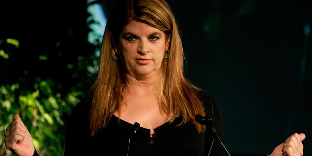 """Kirstie Alley gestures while speaking at the Simmons Leadership Conference in Boston, Massachusetts, April 30, 2005. Alley has just written a memoir entitled, """"How to Lose Your Ass and Regain Your Life."""""""