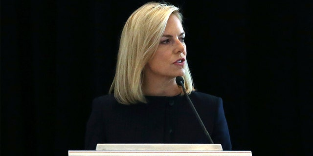 "U.S. Department of Homeland Security Secretary Kirstjen Nielsen addresses a convention of state secretaries of state on Saturday in Philadelphia. Nielsen told the gathering that there are no signs that Russia is targeting this year's midterm elections on the same ""scale or scope"" it targeted the 2016 presidential election."