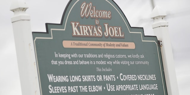 A sign at the entrance of the Hasidic village of Kiryas Joel in New York informs visitors of the dress code and gender separation rules.