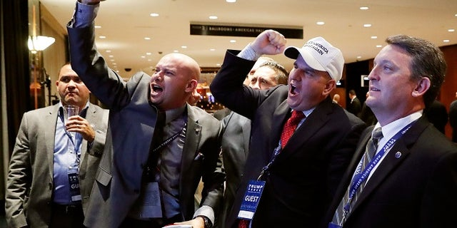 Members of the National Border Patrol Council cheer for President Trump during Election Day.