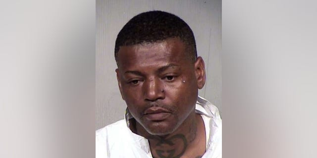 Melvin Harris III was accused of fatally beating a man after the suspect allegedly tried to enter his daughter's locked restroom stall. (Maricopa County Sheriff's Office)