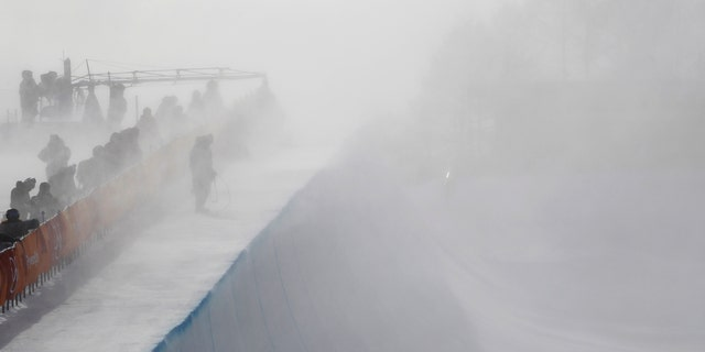 Wind gust engulfs the half pipe course during the women's halfpipe qualifying at Phoenix Snow Park in Pyeongchang, South Korea.