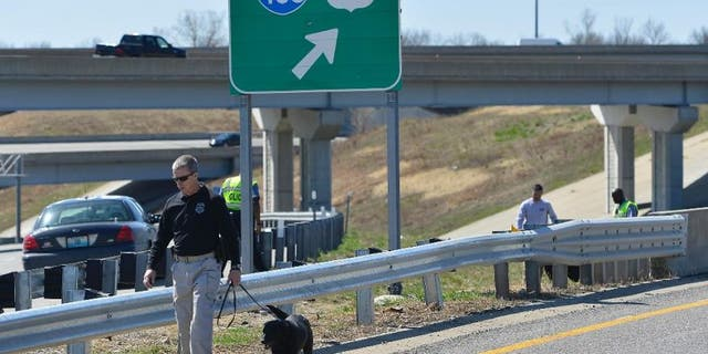 April 9, 2014: Kansas City police and agents from the Alcohol, Tobacco and Firearms with canines investigated a shooting along southbound Interstate 435 in Kansas City, Mo.