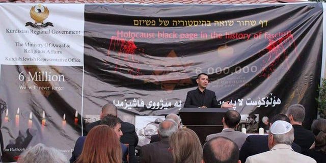 Sherzad Omer Mamsani, who the Kurdish government appointed to reach out to Jews, speaks at the region's first Holocaust remembrance ceremony.