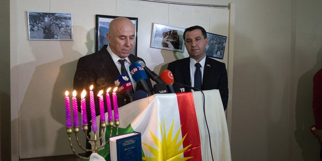 Nevzat Hadi, mayor of Erbil, addresses Kurdish Jews Friday as Sherzad Omer Mamsani looks on.