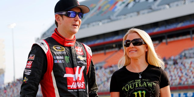 In 2014, Kurt Busch, left, stands with Patricia Driscoll before qualifying for a NASCAR Sprint Cup series auto race at Charlotte Motor Speedway in Concord, N.C.