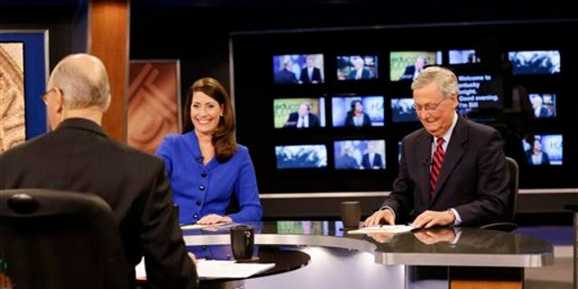 """Oct. 13, 2014: U.S. Senate Republican Minority Leader Mitch McConnell Ky.,  right, and  Democratic opponent, Kentucky Secretary of State Alison Lundergan Grimes, rehearse before their appearance on """"Kentucky Tonight"""" in Lexington, Ky."""
