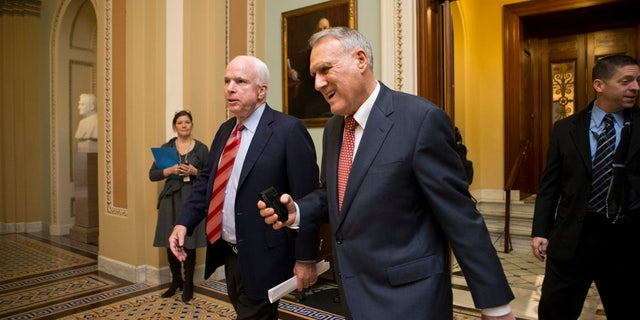 In this Dec. 30, 2012, file photo, Sen. John McCain, R-Ariz., left, and then-Senate Minority Whip Jon Kyl, R-Ariz., leave the chamber as the Senate.