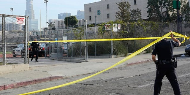 Police tape off the Salvador B. Castro Middle School on Feb. 1.