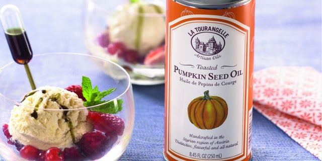 Toasted Pumpkin Seed Oil over ice cream topped with fruit.