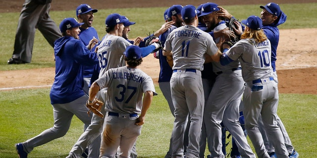 The Los Angeles Dodgers players celebrate after Game 5 of baseball's National League Championship Series against the Chicago Cubs, Thursday, Oct. 19, 2017, in Chicago.