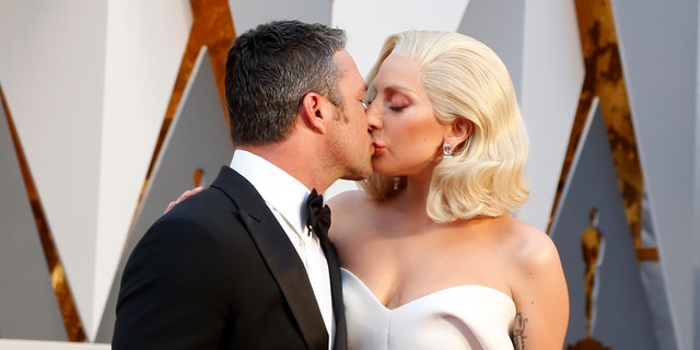 Presenter Lady Gaga arrives with boyfriend Taylor Kinney at the 88th Academy Awards in Hollywood, California February 28, 2016.  REUTERS/Lucy NicholsonTPX IMAGES OF THE DAY - RTS8FHG