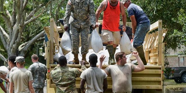 Aid workers help flood victims in Denham Springs, La.