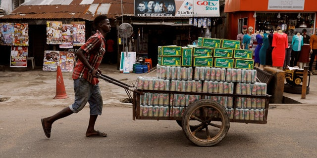 A man pushes a cart in Nigeria's commercial capital Lagos.