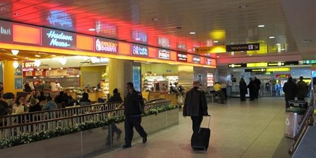 Jan. 10, 2014: Passengers maneuver through one of the cramped hallways at New York's LaGuardia Airport.