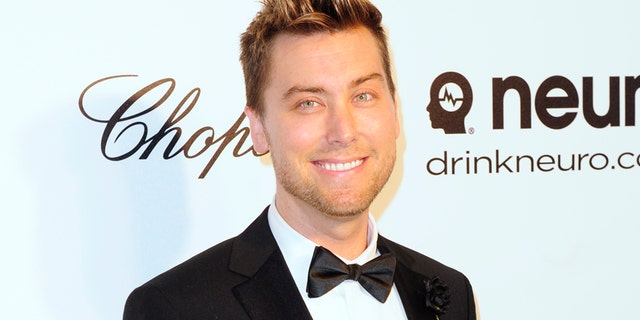 Pop singer Lance Bass arrives at the 2014 Elton John AIDS Foundation Oscar Party in West Hollywood, California March 2, 2014.