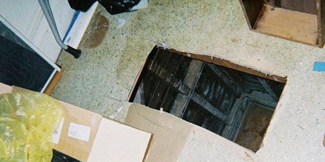 UNDATED: This photo released by the San Francisco Office of the District Attorney show a hole cut into the floor of a San Francisco apartment.