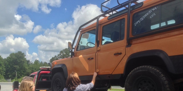 Attorney Christina Clodfelter watches as her client Jennifer Brinkley is reunited with her Land Rover Defender. Federal authorities had seized the vehicle last summer. (Fox News)