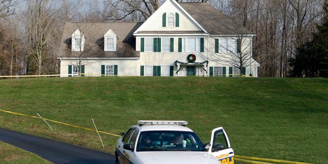 Dec. 18, 2012: A police cruiser sits in the driveway of the home of Nancy Lanza in Newtown, Conn., the Colonial-style house where she had lived with her son Adam Lanza. (AP)