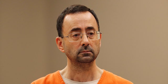 In this Nov. 22, 2017 file photo, Dr. Larry Nassar, 54, appears in court for a plea hearing in Lansing, Mich. Nasser, a sports doctor accused of molesting girls while working for USA Gymnastics and Michigan State University pleaded, guilty to multiple charges of sexual assault and will face at least 25 years in prison.