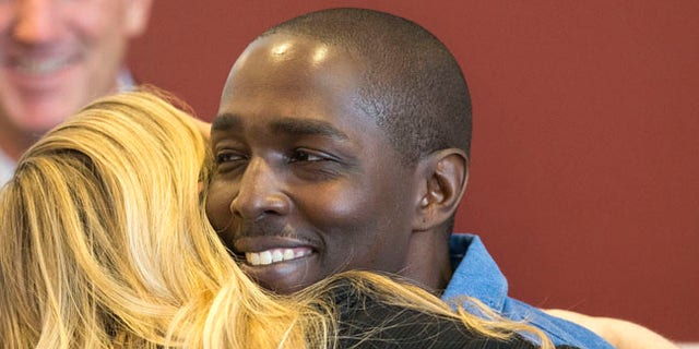 "DeMarlo Berry hugs his attorney Samantha Wilcox following a news conference after his exoneration held at the law office of Eglet Prince in downtown Las Vegas on Friday, June 30, 2017. The 42-year-old Nevada man freed from prison after 23 years behind bars for a crime he didn't commit said Friday he felt ""a little overwhelmed"" by changes in the city where he was arrested when he was 19. (Richard Brian/Las Vegas Review-Journal via AP)"