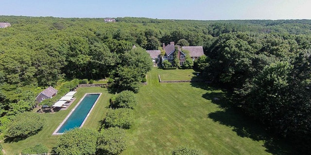 The estate features a 70-foot heated pool, pool house, wet bar, tennis court and secret garden.
