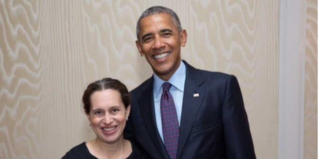 Lauren Baer with former President Barack Obama.