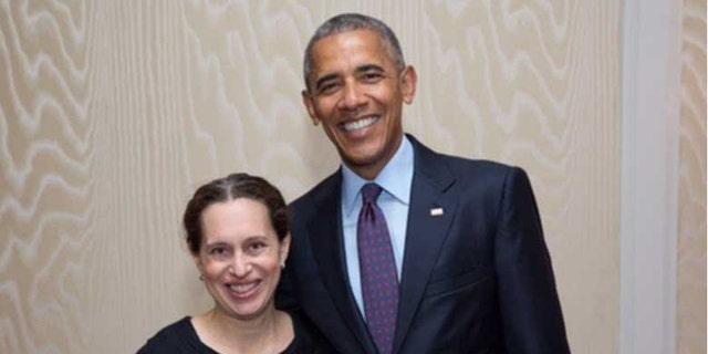 Lauren Baer with former President Barack Obama.