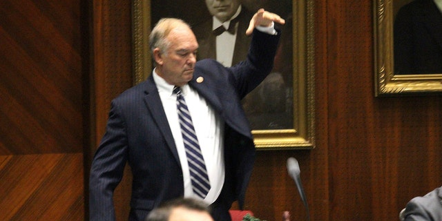 Arizona Republican state Rep. Don Shooter drops his mic after voting no on a resolution expelling him from the Arizona House for a pattern of sexual harassment in Phoenix, Ariz., Thursday, Feb. 1, 2018. Shooter's removal from office would be the first known vote kicking out a state lawmaker since revelations against filmmaker Harvey Weinstein spurred a national conversation on workplace harassment. (AP Photo/Bob Christie)