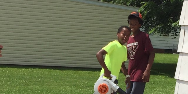Reggie Fields' lawn mowing service is booming after a neighbor called the police on him.