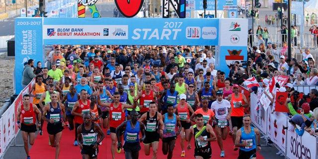 Runners compete in the Beirut Marathon in Beirut, Lebanon, Nov. 12, 2017.