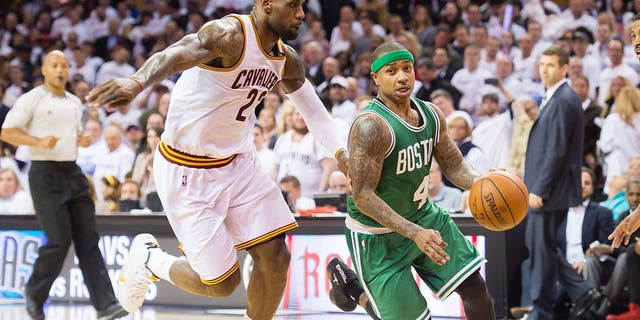 CLEVELAND, OH - APRIL 21: Isaiah Thomas #4 of the Boston Celtics drives around LeBron James #23 of the Cleveland Cavaliers in the second half in Game Two of the Eastern Conference Quarterfinals during the 2015 NBA Playoffs 2015 at Quicken Loans Arena on April 21, 2015 in Cleveland, Ohio. The Cavaliers defeated the Celtics 99-91. NOTE TO USER: User expressly acknowledges and agrees that, by downloading and or using this photograph, User is consenting to the terms and conditions of the Getty Images License Agreement. (Photo by Jason Miller/Getty Images)