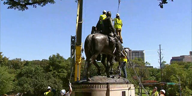 Workers were preparing to remove the statue before a judge's order stopped them.