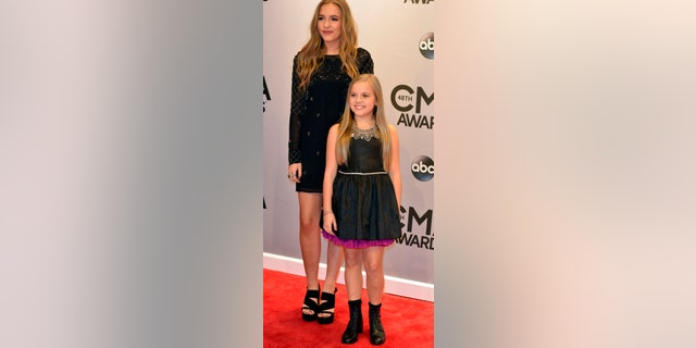 "Lennon (L) and Maisy Stella of the singing group Lennon & Maisy, as well as from the ABC series ""Nashville,"" arrive at the 48th Country Music Association Awards in Nashville, Tennessee November 5, 2014."