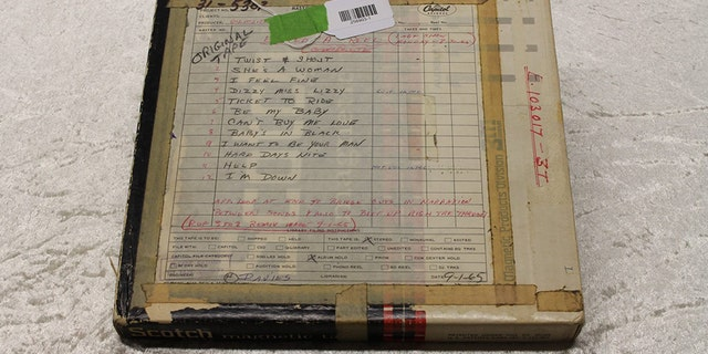 An original tape from a recording and play list of a Beatles concert on Aug. 30, 1965, is displayed at the police headquarters in Berlin, Tuesday.