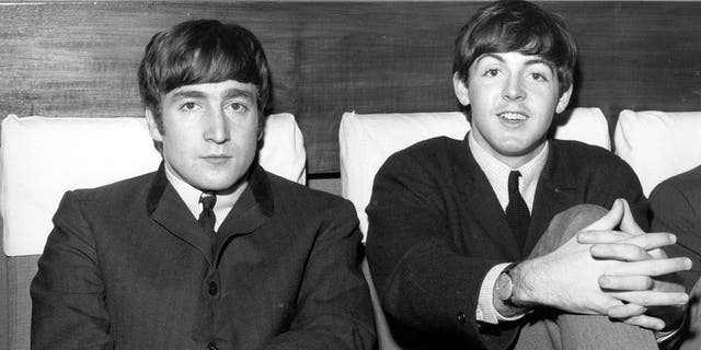 John Lennon (1940 - 1980), singer and guitarist, left, and Paul McCartney, singer and bass guitarist, circa 1963.