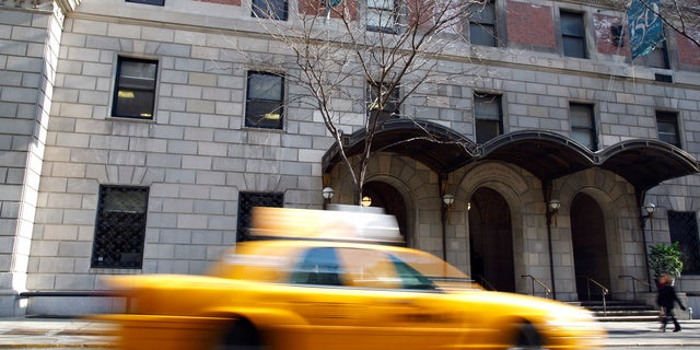 A taxi drives pass the Lenox Hill Hospital in New York, March 18, 2009. REUTERS/Chip East