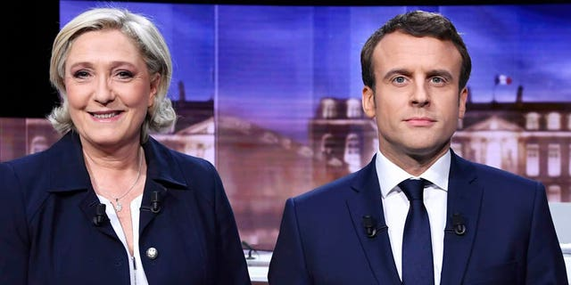 French presidential election candidate for the far-right Front National party, Marine Le Pen, left, and French presidential election candidate for the En Marche! movement, Emmanuel Macron, will face off in the presidential election on Sunday.