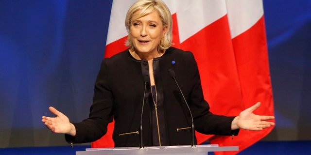 Feb. 5, 2017: Far-right leader presidential candidate Marine Le Pen gestures as she speaks during a conference in Lyon, France.