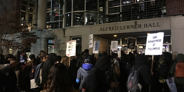 Antifa protesters block the only entrance to a speech on Columbia University's campus by speaker Mike Cernovich.