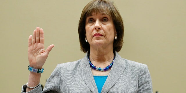 May 22, 2013: U.S. Director of Exempt Organizations for the Internal Revenue Service (IRS) Lois Lerner is sworn in to testify before a House Oversight and Government Reform Committee hearing on alleged targeting of political groups seeking tax-exempt status from by the IRS, on Capitol Hill in Washington. (Reuters)