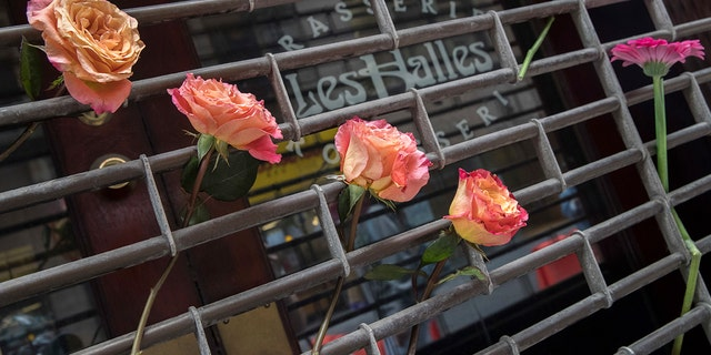 The building that once housed Les Halles is now being covered in flowers, trinkets and notes.