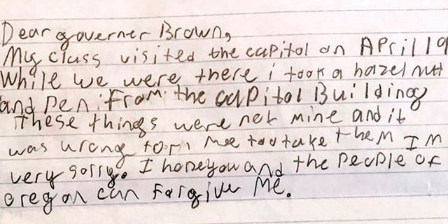 This photo provided by the Office of Oregon Gov. Kate Brown shows a portion of an apology letter from a fourth-grader to Gov. Brown, explaining that his class had toured the Capitol on a field trip in April 2017 and how he took a hazelnut and a pen from the Capitol Building.