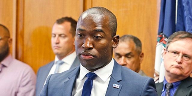 FILE- In this June 22, 2017, file photo Richmond Mayor Levar Stoney gestures during a news conference at City Hall in Richmond, Va. In the wake of a violent white nationalist rally in Charlottesville, Stoney says his city should consider removing or relocating its Confederate statues. Stoney's announcement Wednesday is a reversal from a position he took earlier this year. In June, he said he thought the monuments should stay but have context added about what they represent and why they were built. (AP Photo/Steve Helber, File)
