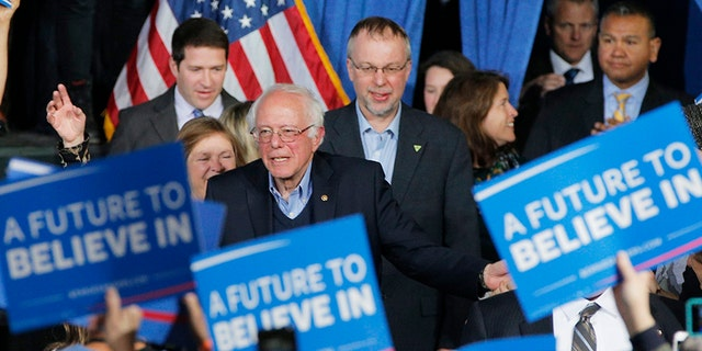 Levi Sanders stands behind his father Sen. Bernie Sanders, I-Vt., in 2016 during his Democratic primary presidential run.