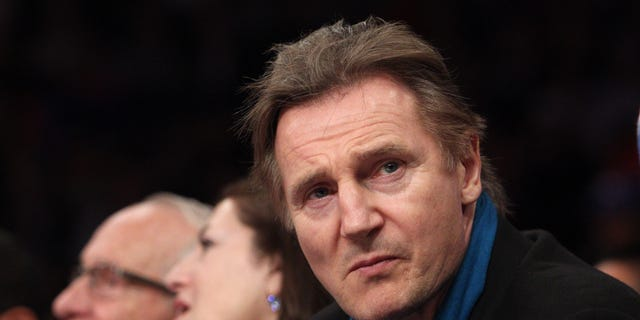 Irish actor Liam Neeson sits court side during the first quarter of a game between the New York Knicks and the Miami Heat at Madison Square Garden.