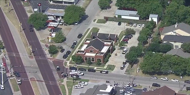 At least three people were shot when two suspects opened fire inside a bank, police said.