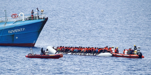 """Migrants on a dinghy are rescued by German NGO Jugend Rettet ship """"Juventa"""" crew in the Mediterranean sea, off the coast of Libya June 18, 2017. Italy accuses the NGO of working in cahoots with traffickers."""